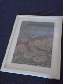 Printed material with poppies ,barley and daisies in wooden cream frame.