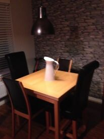 Lovely dining table with 2 chairs
