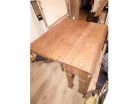 Heavy solid oak folding table in need of repair.