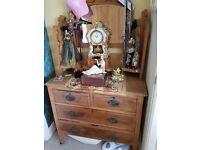 Wooden dresser chest with ornate mirror