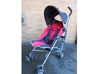 Maclaren stroller red and black with hood and rain cover. £25.