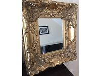Gifted ornate wall mirror