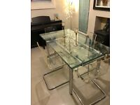 Contemporary extendable glass dining table and chairs