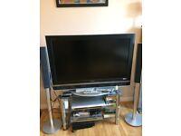 sony tv 40 inch 4 sony freestanding speakers. 3tier glass stand, sony dvd player