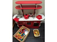 Hardly used ELC wooden kitchen including plastic food and pots