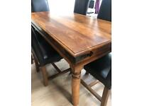 Large Hard Indian Wood Table and 6 Black Leather Dining Chairs
