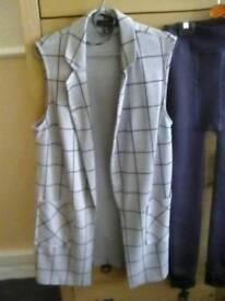Grey sleevles jacket