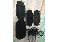 PSP 1000 – Including Logitech Case, Original Charger, Sleeve and Rubber Case and games.
