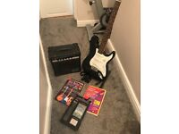 C.Giant electri guitar, amp and accessories