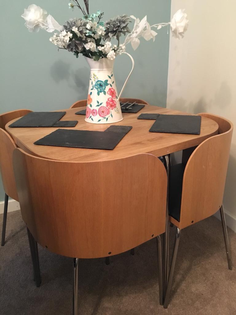 Space-saving dining table and matching chairs