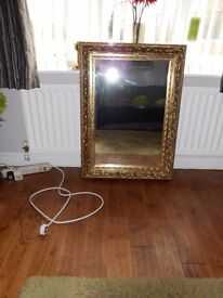 LARGE GOLD SURROUND WALL MIRROR.