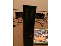 X box 360 with 2 controllers and games used 3 times. 1 year old