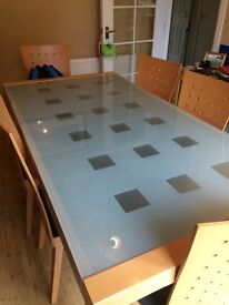 Glass topped dining table, plus 6 chairs.
