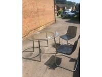 4 seater Dinning table + X2 chairs