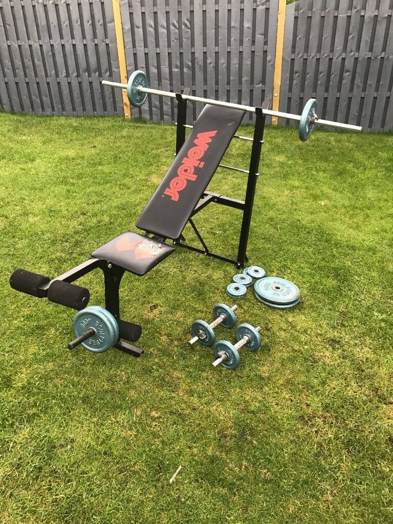 Weight bench, straight bar, dumbbells and assorted weights