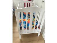 White cot with bedding, lovely condition.
