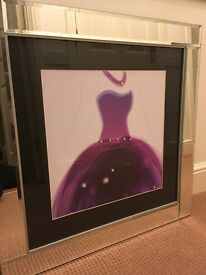Striking picture in a fairly heavy bevelled mirror frame of lady's violet purple gown with crystals