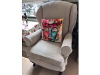 Beige High Backed Winged armchair with removable washable covers