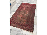Eastern Rug , red in colour , size 200cm x 110cm . Does have worn areas , but still a good rug.
