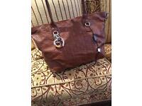 Gucci ladies brown hand bag shoulder embossed gg logo