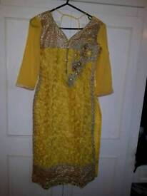 Indian yellow suit