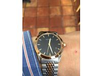 Men's rose gold and silver Gucci watch