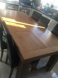Large solid oak table with chairs