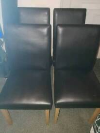 4 chocolate colour leatherette dining chairs,with oak effect legs