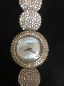 Seksy mother of pearl watch face with Swarovski crystals