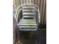 Two aluminium garden chairs
