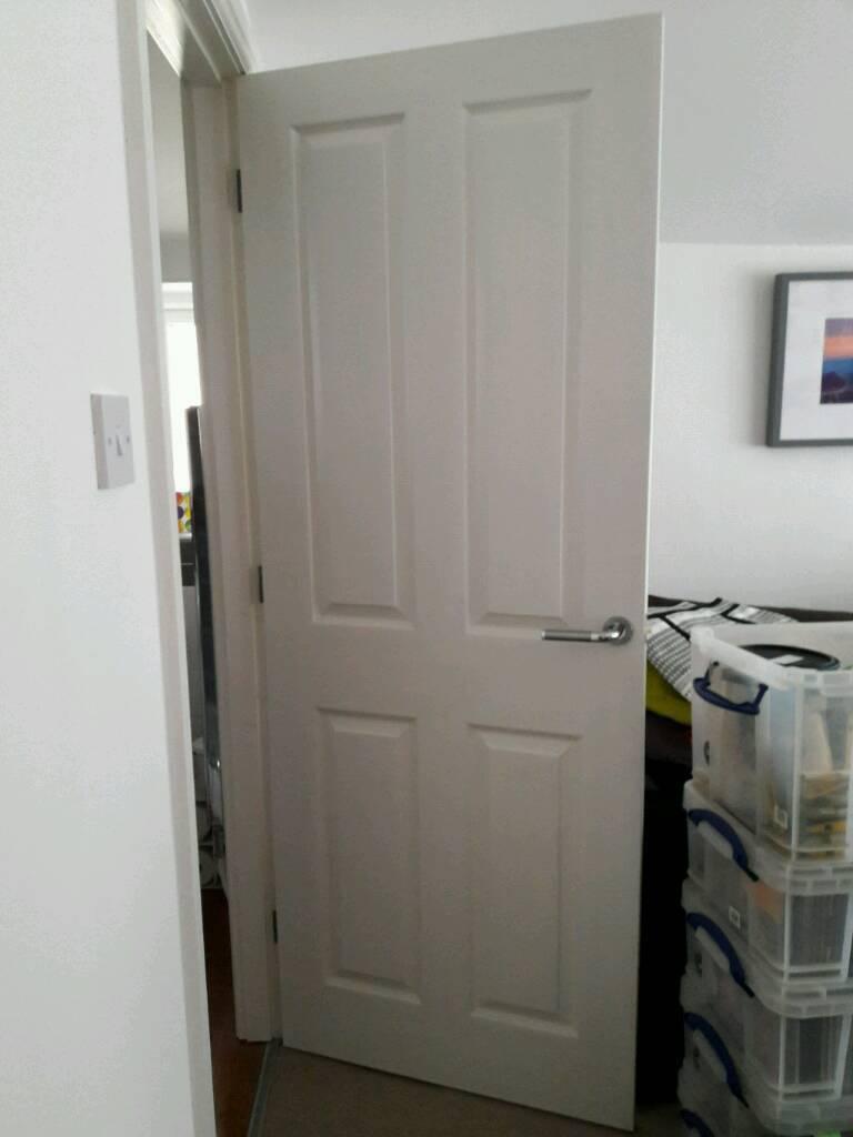 5 white doors