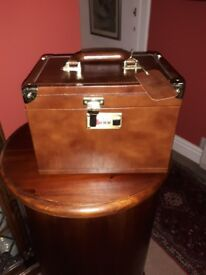 Leather covered jewellery carrying box.