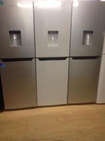 White fridge freezer with waterdispenser