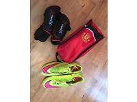 Football boots, shin pads and bag