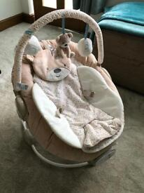 Baby seat. Vibrates and plays music.