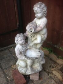 Stone appearance cherub garden fountain ornament