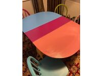 Colourful table and 4 chairs