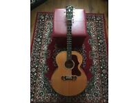 Gibson J 100 Xtra. Jumbo acoustic guitar with original hard shell case.