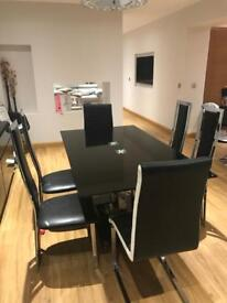 Black glass table and chairs