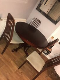 Extending wood dining table and 4 chairs