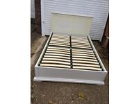 White wooden double bed frame with dresser/mirror/stool and bedside drawers