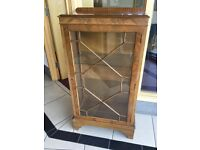 Glass front antique walnut, display cabinet