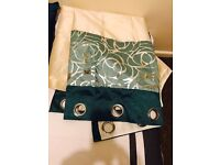 Teal patterned curtains with cushion cover