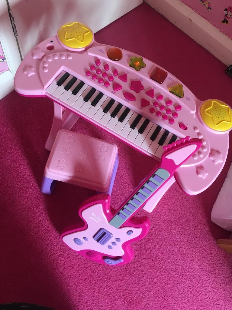Musical keyboard and guitar
