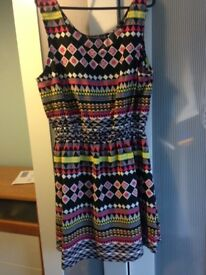 Two *Dresses** new with tags ** size 14- 18