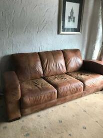 Three seater DFS brown leather sofa
