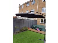 Cantilever parasol with stand
