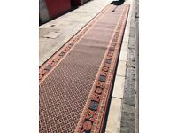 Very Large Wool Runner Rug - Blue field with decorative border .