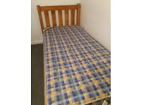 Excellent condition Solid pine single bed frame with mattress.