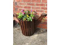 Wooden watering can planter